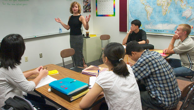 An English language learner teacher interacts with her students